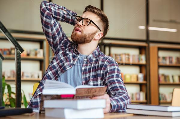 Portré töprengő szakállas férfi diák szemüveg Stock fotó © deandrobot