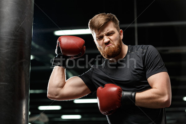 Emotional handsome young strong sports man boxer Stock photo © deandrobot