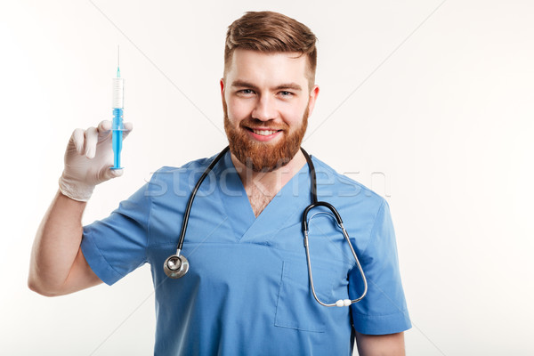 Portrait of a smiling happy medical doctor or nurse Stock photo © deandrobot