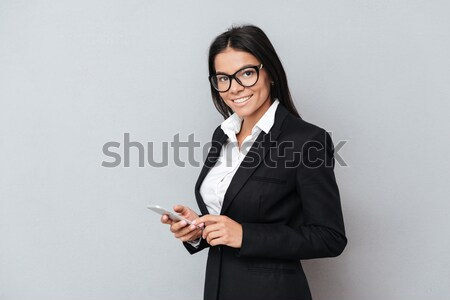 Happy pregnant business lady pointing to watch. Stock photo © deandrobot