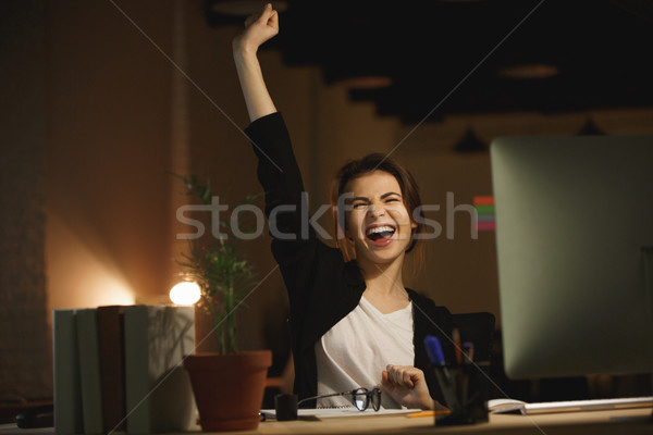 Yawning young woman designer sitting in office at night Stock photo © deandrobot