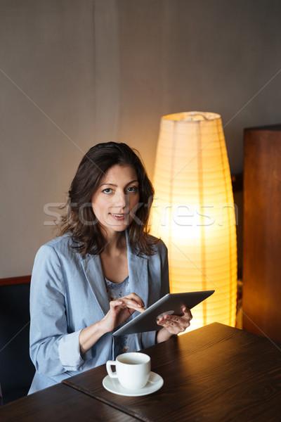женщину сидят изображение Сток-фото © deandrobot
