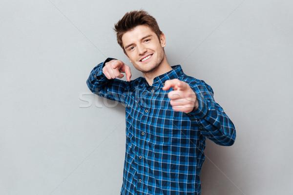Jonge man wijzend camera kiezen jonge vrolijk Stockfoto © deandrobot