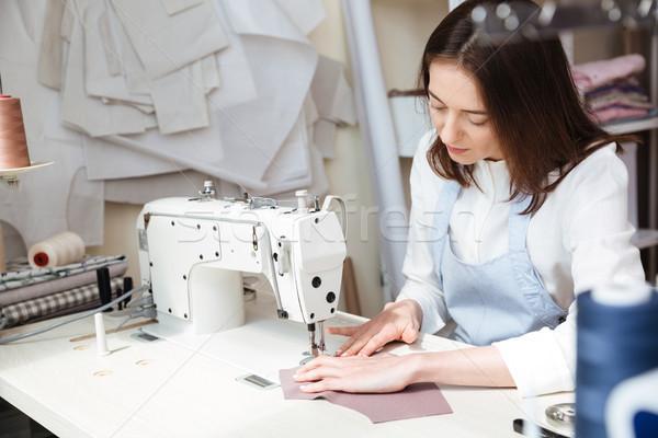 изображение рабочих швейные машины брюнетка фартук семинар Сток-фото © deandrobot