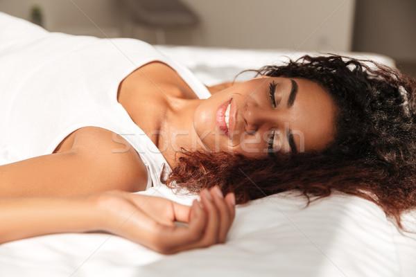 Młodych Afryki kobieta cieszyć się słońce bed Zdjęcia stock © deandrobot