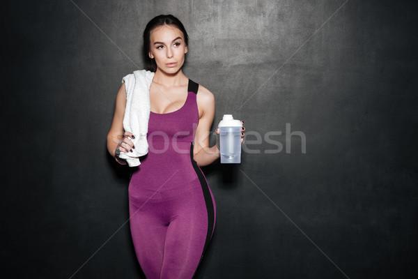 Młoda kobieta dres ręcznik manierka portret Zdjęcia stock © deandrobot