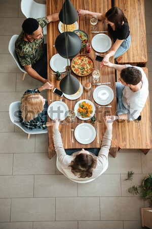 Top view of five people cheering with wine Stock photo © deandrobot