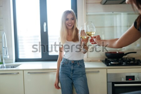Cropped image of two women looking into fridge Stock photo © deandrobot