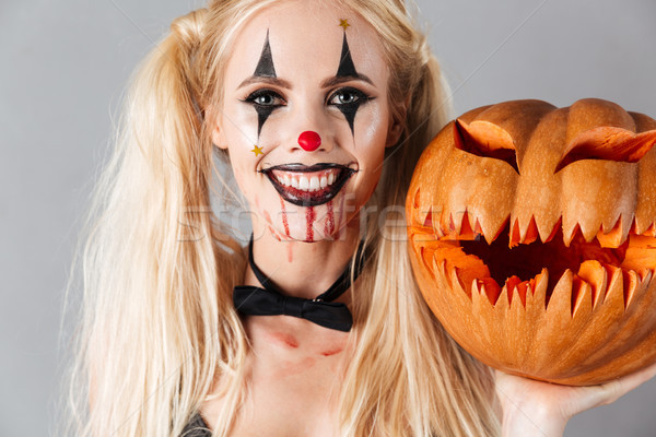 Close up of a blonde woman in halloween clown make-up Stock photo © deandrobot