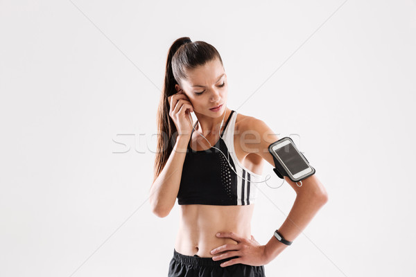 Portrait of a healthy young fitness woman in sportswear Stock photo © deandrobot