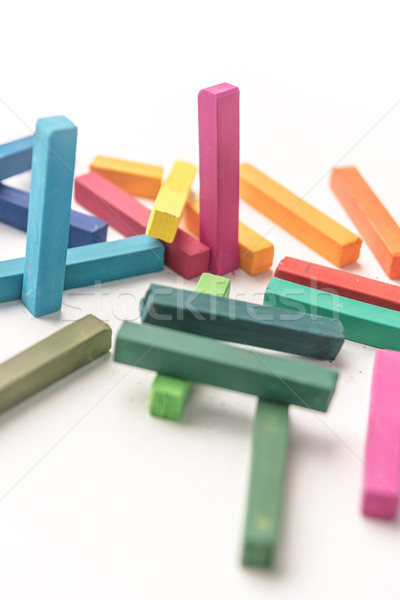 Cropped photo of group colored pastel chalks in a chaotic manner Stock photo © deandrobot