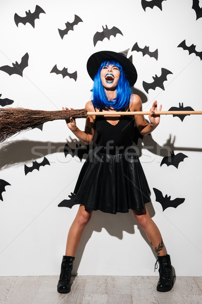 ?motional screaming young woman witch. Stock photo © deandrobot