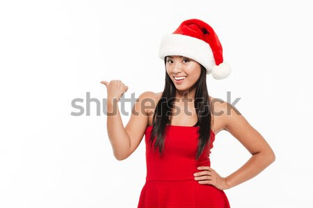 Stock photo: Portrait of a pretty asian woman in red christmas costume