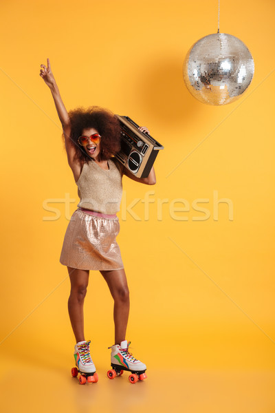Full length portrait of happy afro american disco woman in sungl Stock photo © deandrobot