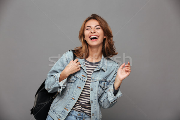 Portrait of a joyful pretty girl in denim jacket Stock photo © deandrobot