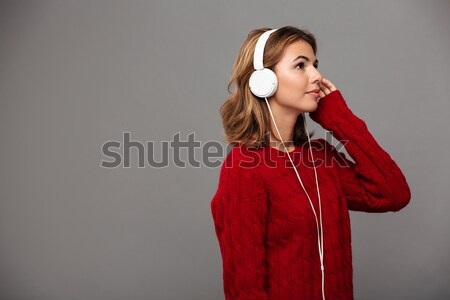 Side view of a young girl in red sweater Stock photo © deandrobot