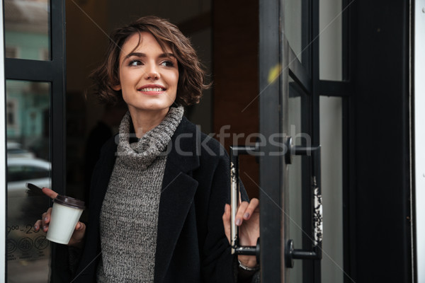 Portrait of a pretty girl dressed in autumn clothes Stock photo © deandrobot