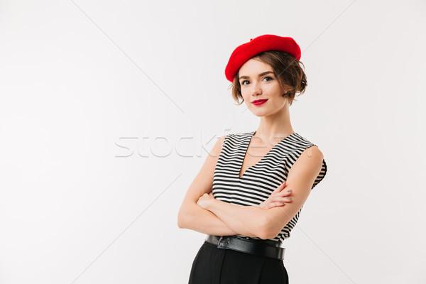 портрет улыбающаяся женщина красный берет Постоянный оружия Сток-фото © deandrobot