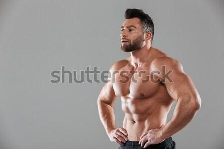 Vista lateral retrato concentrado forte sem camisa masculino Foto stock © deandrobot