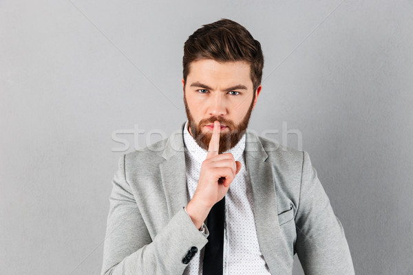 Portrait of a handsome businessman dressed in suit Stock photo © deandrobot