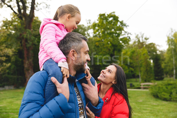 Beautiful young family spending time together outdoors Stock photo © deandrobot