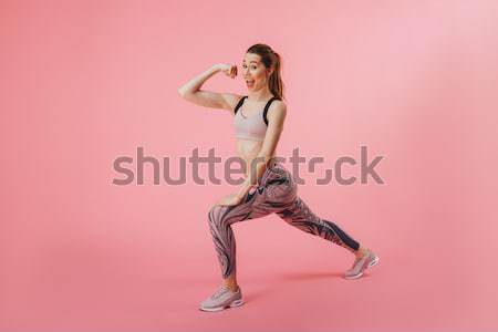 Full length portrait of a cheery pretty girl posing Stock photo © deandrobot