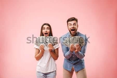 Excité couple école argent Photo stock © deandrobot