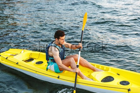 Man paddling a kayak Stock photo © deandrobot
