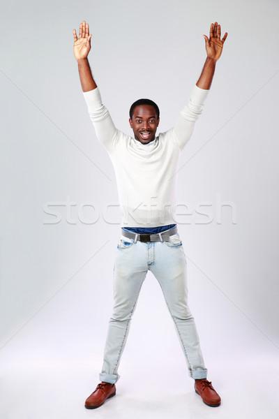 Retrato África hombre las manos en alto gris Foto stock © deandrobot