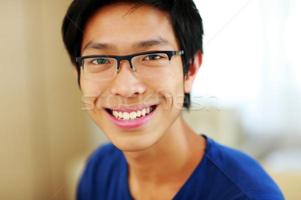 Closeup portrait of a happy asian man Stock photo © deandrobot