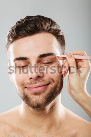 Fiatalember frissítő arc izolált fehér haj Stock fotó © deandrobot