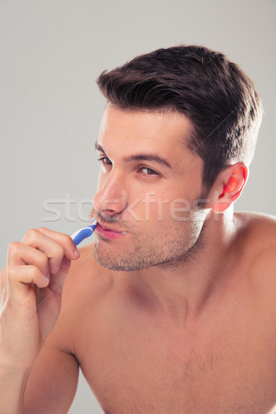 Retrato caucásico hombre gris feliz Foto stock © deandrobot