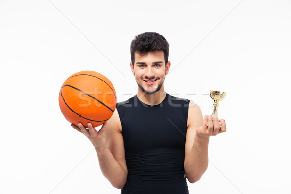 Stock photo: Basketball player holding winners cup