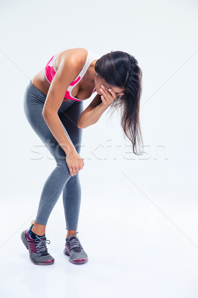 Full length portrait of a woman having pain Stock photo © deandrobot
