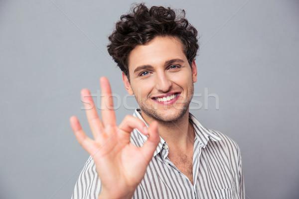 Mutlu gündelik adam neden imzalamak Stok fotoğraf © deandrobot