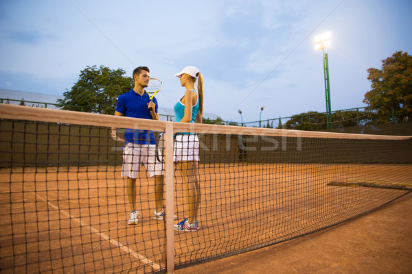 Man and woman talking at the tennis court Stock photo © deandrobot