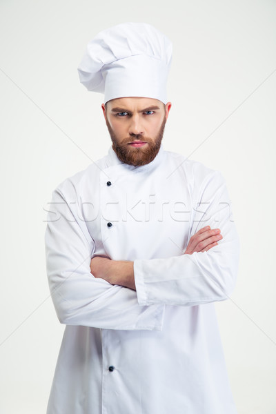 Male chef cook standing with arms folded Stock photo © deandrobot