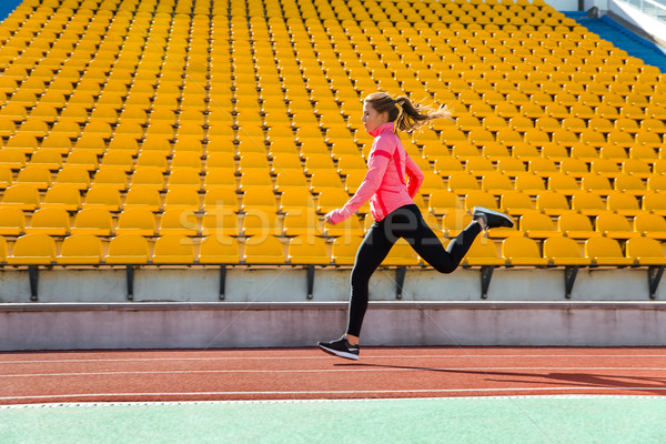 Woman running at stadium Stock photo © deandrobot