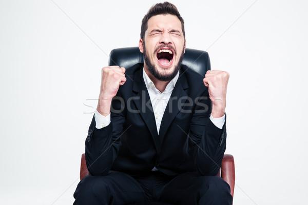 Encantado feliz barbudo jovem empresário sessão Foto stock © deandrobot