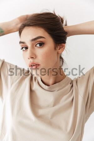 Gyengéd bájos nő megnyugtató ágy fiatal nő Stock fotó © deandrobot