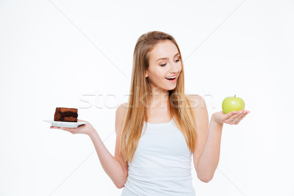 Cheerful woman choosing between healthy and unhealthy food Stock photo © deandrobot