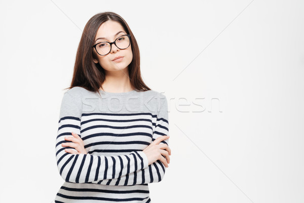 Serious woman in glasses and arms folded Stock photo © deandrobot