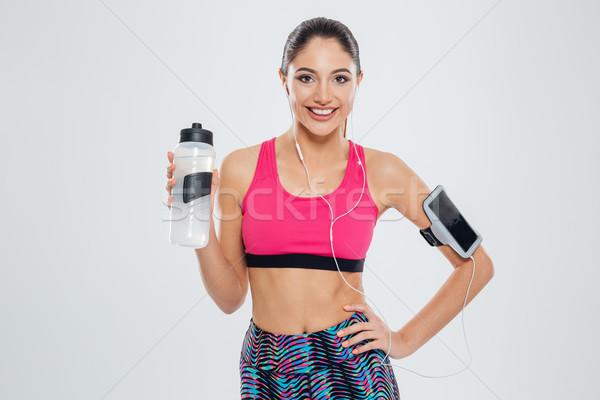 Gülümseyen kadın shaker su yalıtılmış beyaz Stok fotoğraf © deandrobot