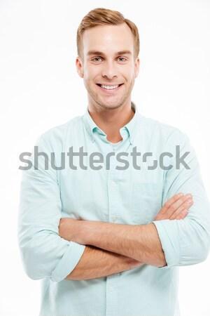 Portrait heureux homme permanent bras Photo stock © deandrobot
