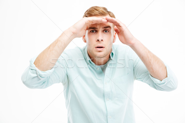 Serious young businessman straring and looking far away Stock photo © deandrobot