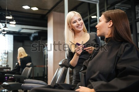Girl discussing haircut with her female hairdresser in hairdressing salon Stock photo © deandrobot