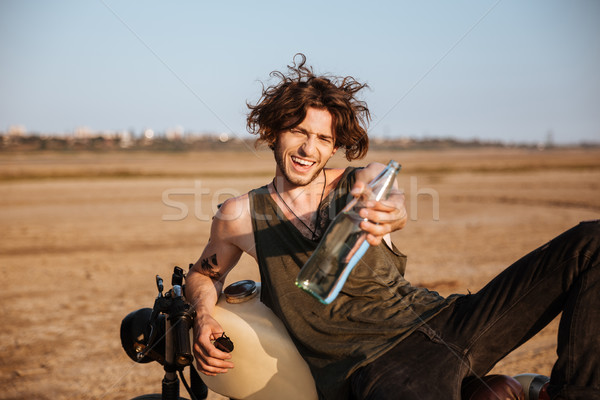 Fiatal brutális férfi fektet motorkerékpár üveg Stock fotó © deandrobot