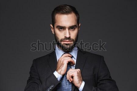 молодые брюнетка человека синий куртка Сток-фото © deandrobot