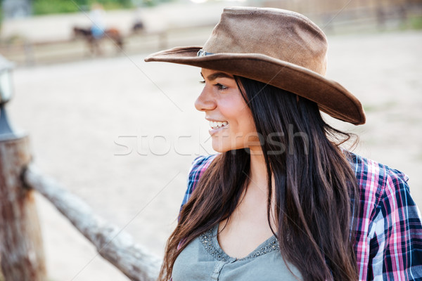 Smiling pretty young woman cowgirl in hat Stock photo © deandrobot