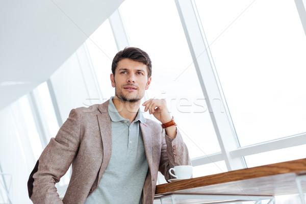 Töprengő üzletember kávészünet bent üzlet férfi Stock fotó © deandrobot